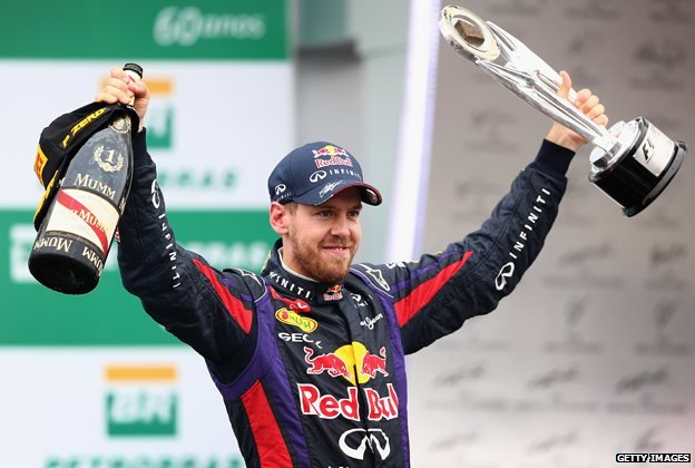 Sebastian Vettel with the Brazilian Grand Prix trophy in November 2013