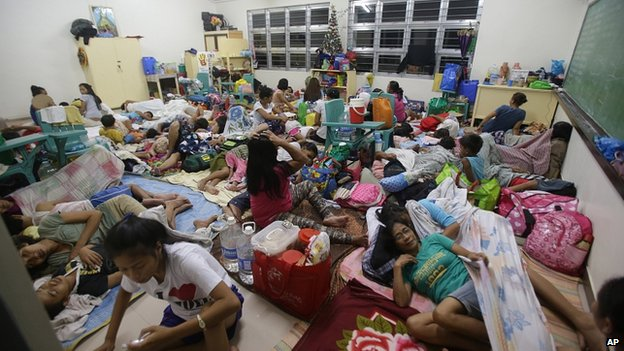 People shelter from typhoon in Legazpi. 6 Dec 2014
