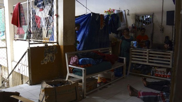 People rest in a room of the detention centre in Indonesia