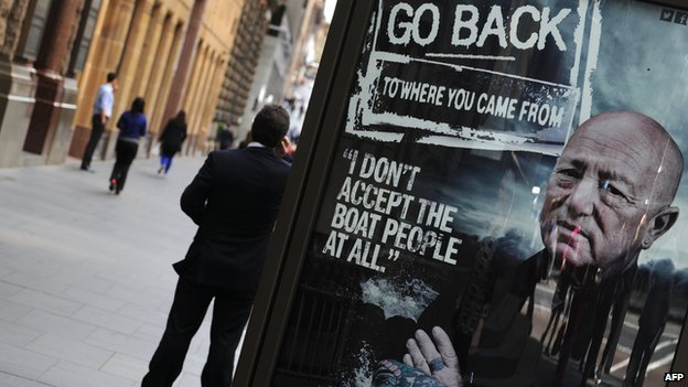 A poster is displayed on a street board in Sydney on 30 August, 2012