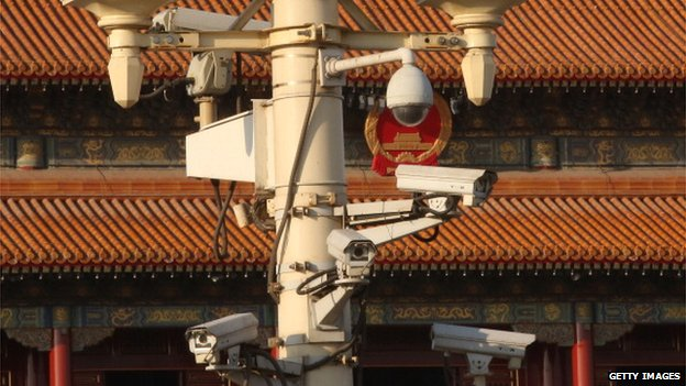 Security cameras hang on a lamp at the Tiananmen Square ahead on 1 March, 2014 in Beijing, China