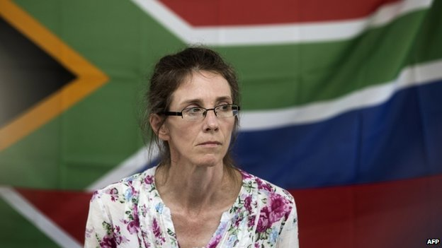 South African Yolande Korkie, a former hostage and wife of Pierre Korkie, holds a press conference in Johannesburg in January 2014