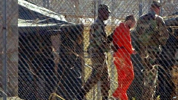 Prisoner being moved at Guantanamo detention centre, 2002