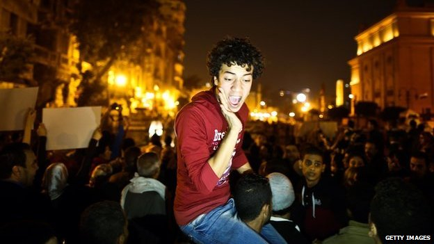 Egyptian anti-Mubarak protesters chant slogans as they gather in Tahrir Square in Cairo on November 29, 2014.
