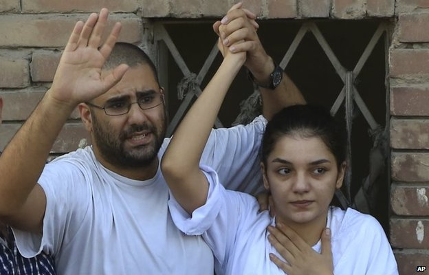 Alaa Abdel-Fattah (left) with his sister Sanaa Seif at their father's funeral in Cairo (28 August 2014)