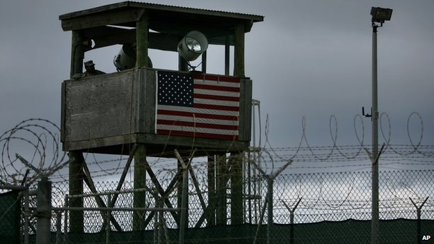A guards sits in a tower overlooking Guantanamo detention camp at Guantanamo Bay US Naval Base, Cuba, Tuesday, May 15, 2007