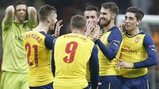 Arsenal players celebrate after Aaron Ramsey's goal