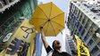 Woman with yellow umbrella in Hong Kong