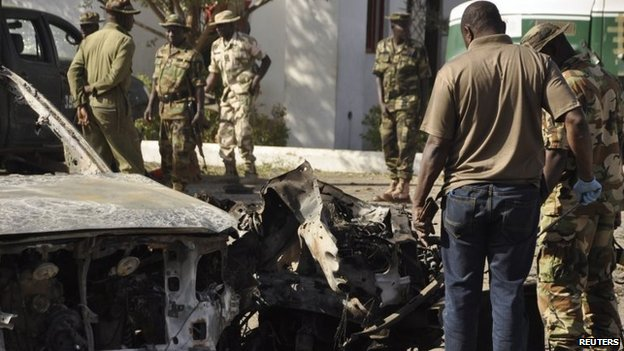 File photo: Bomb experts and military personnel investigate the site of an explosion at a police station in Kano, 15 November 2015