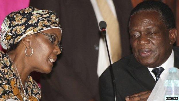 Grace Mugabe, wife of Zimbabwean President Robert Mugabe, talks to Vice-President Emmerson Mnangagwa (R) in Harare on 10  December 2014