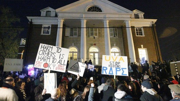 Protestors gather outside the fraternity house where an alleged gang rape took place.