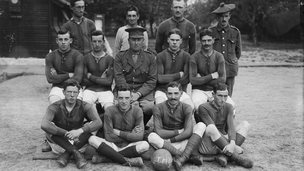 Uniformed soldiers with football in WW1