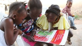 Girls looking at a poster about Ebola