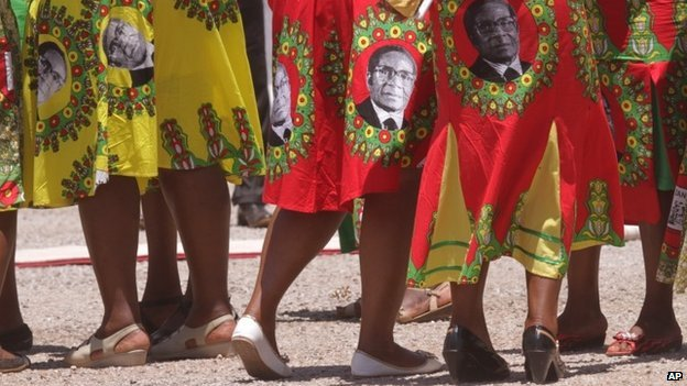 Supporters of Zimbabwean President Robert Mugabe sing and dance while waiting for his arrival on the last day of the Zanu-PF 6th National Congress in Harare on  6 December 2014