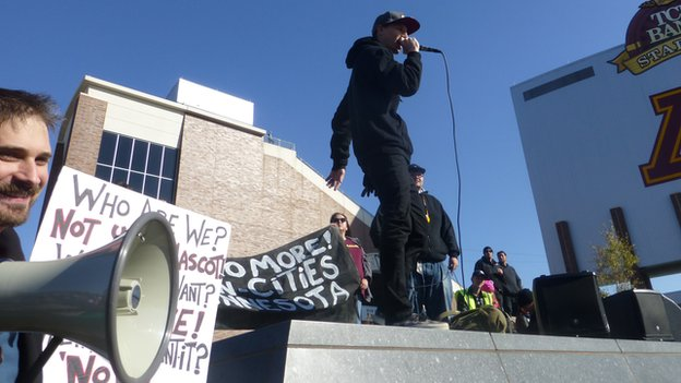 Hip-hop artist Jordan Brien - aka Mic Jordan - performs outside of a Washington Redskins game in Minnesota