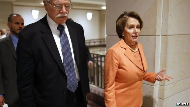 US House Minority Leader Nancy Pelosi (right) and Representative George Miller depart after a House Democratic Caucus meeting at the US Capitol in Washington, 11 December 2014