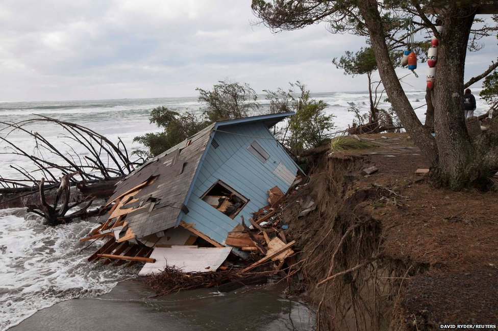 A house collapses into the sea at Washaway Beach, Washington
