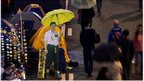 "A cardboard cut-out of Chinese President Xi Jinping (C) carrying a yellow umbrella is seen at the pro-democracy movement""s main protest site in the Admiralty district of Hong Kong on 2 December 2014"
