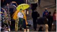 """A cardboard cut-out of Chinese President Xi Jinping (C) carrying a yellow umbrella is seen at the pro-democracy movement""""s main protest site in the Admiralty district of Hong Kong on 2 December 2014"""