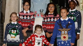 Children in Christmas jumpers