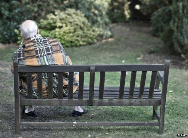 Dementia patient sitting on bench