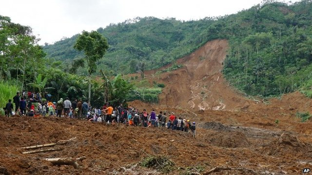 Villagers and rescuers at site of landslide