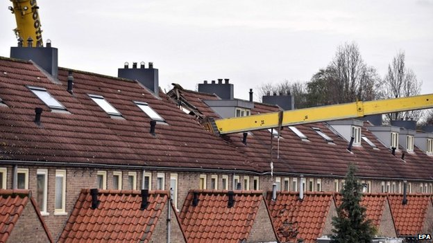 A crane which fell into the roof of a house in the Netherlands