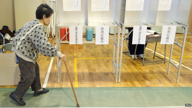 Japanese elderly voter enters a polling station for the general elections in Isumi city, Chiba province, Japan, 14 December 2014