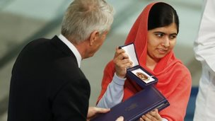 Nobel Peace Prize laureate Malala Yousafzai receives the medal and the diploma during the Nobel Peace Prize awards ceremony at the City Hall in Oslo, 10 December 2014