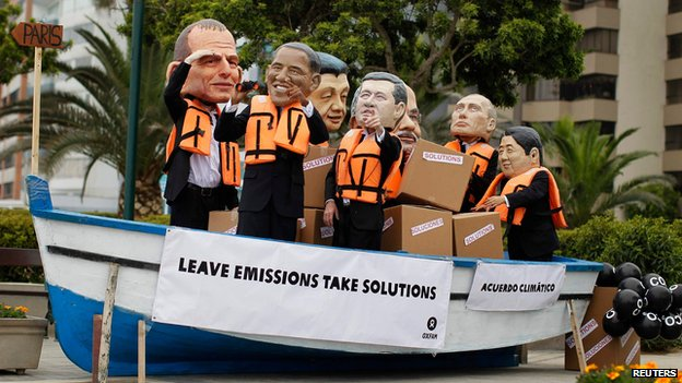Activists wearing masks depicting (left to right) US President Barack Obama, Australian Prime Minister Tony Abbott, Canadan Prime Minister Stephen Harper, Chinese President Xi Jinping, Russian President Vladimir Putin and Indian Prime Minister Narendra Modi demonstrate to demand cuts in global emissions during the COP 20 meeting.