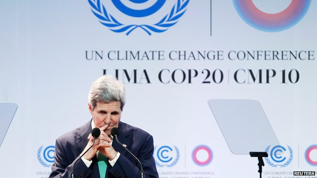 US Secretary of State John Kerry gestures while delivering a speech at the UN Climate Change Conference.
