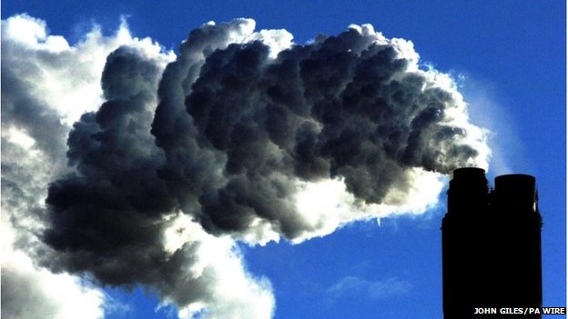 Photo of smoke billowing from a coal-fired power station.