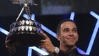 Lewis Hamilton holding SPOTY trophy