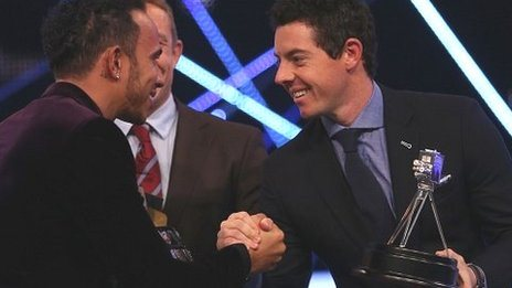 Winner of Sports Personality of the Year 2014, Lewis Hamilton shakes hands with second placed Rory McIlroy