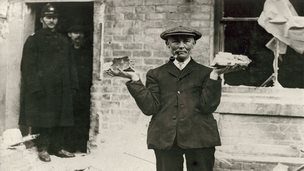 Man holding shell fragments