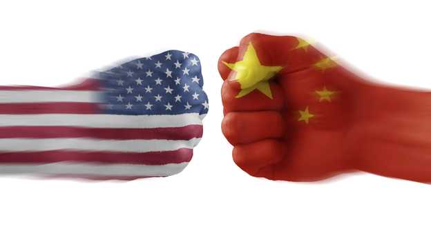 Hands painted with the US and Chinese flags doing a fist bump