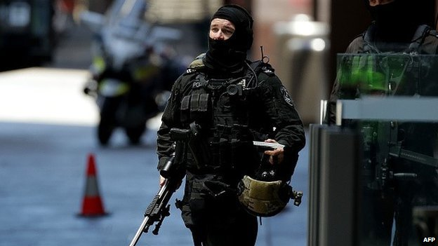An armed policeman is seen in Phillip St on December 15, 2014 in Sydney, Australia. Police attend a hostage situation at Lindt Cafe in Martin Place.