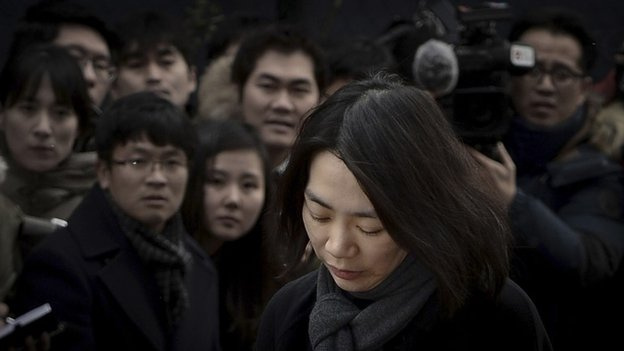 Cho Hyun-ah, also known as Heather Cho, daughter of chairman of Korean Air Lines, Cho Yang-ho, appears in front of the media outside the offices of the Aviation and Railway Accident Investigation Board of the Ministry of Land, Infrastructure, Transport, in Seoul December 12, 2014.