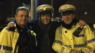 Jimmy Osmond with police officers