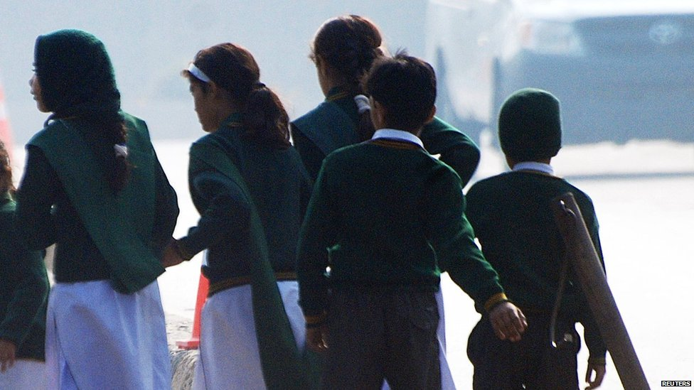 School children fleeing from the scene of an armed incident in Peshawar