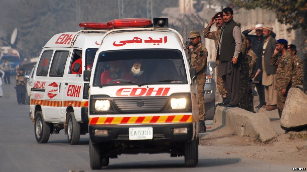 Ambulances near a school which was attacked by gunmen in Peshawar