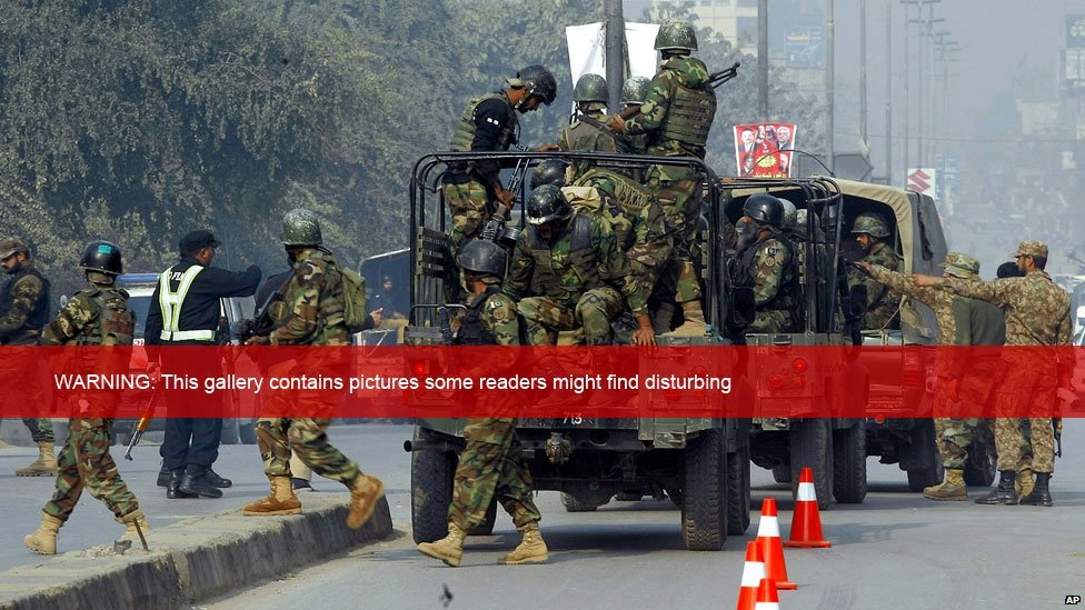 Pakistani army troops arrive at the scene of an armed incident in Peshawar