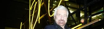 Willy Russell with 'words' neon artwork