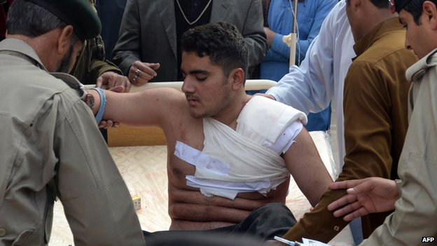 An injured student receiving medical treatment in Peshawar, Pakistan