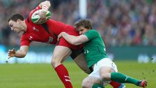 Wales winger George North is tackled by Ireland's Andrew Trimble