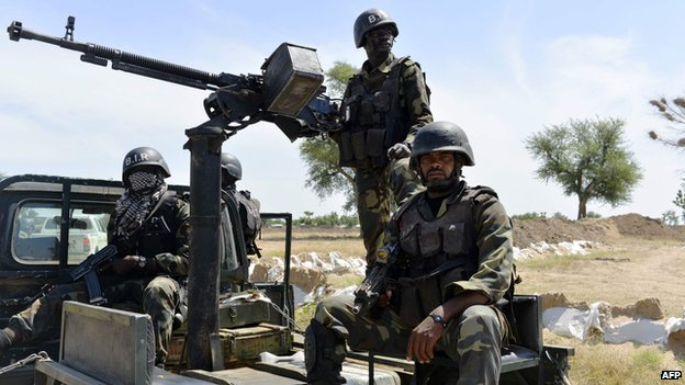 Cameroonian soldiers patrol on 12 November 2014 in Amchide, northern Cameroon, 1 km (1.6 mi) from Nigeria.