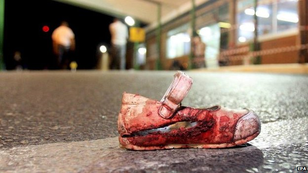 Bloody shoe on ground