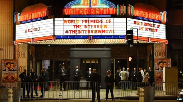 "Security is seen outside The Theatre at Ace Hotel before the premiere of the film ""The Interview"" in Los Angeles, California, on 11 December 2014"