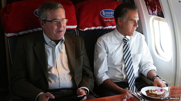 Jeb Bush and Mitt Romney sit together on a campaign plane in 2012.