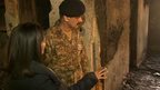 Pakistan army officer showing BBC reporter Mishal Hussain a burned out room in the Peshawar school attacked by the Taliban